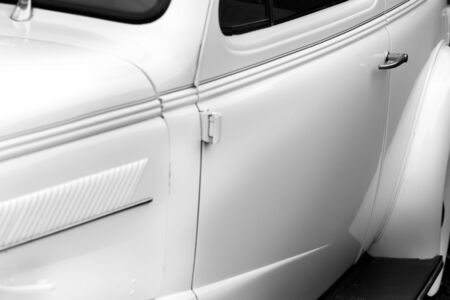 shiny car: Close-up of car handle of a white shiny classic vintage car