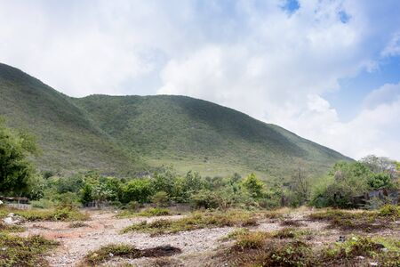 physical geography: Hill against cloudy sky, Trinidad, Trinidad And Tobago Stock Photo