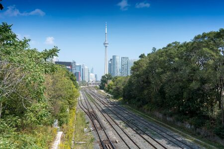 building cn tower: View of CN Tower from railroad tracks, Toronto, Canada