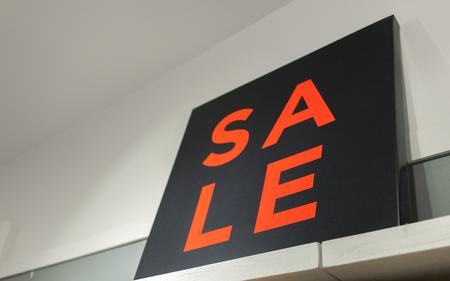 western script: Sale sign on shop Stock Photo