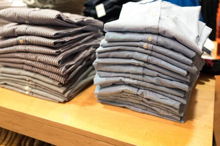 Stack of shirts in clothes shop