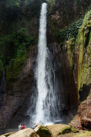 fortuna: Tourist in La Fortuna Waterfall in a forest, Alajuela Province, Costa Rica