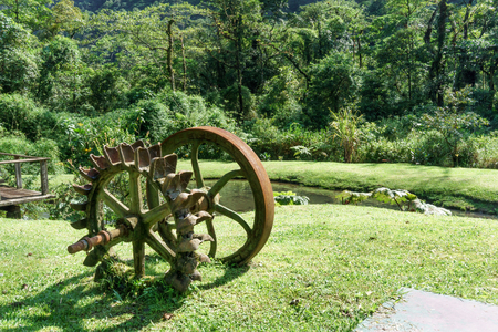 water wheel: Water wheel on field in a forest, Costa Rica Stock Photo