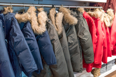 clothes rail: Rail of fur coats hanging in clothes shop Stock Photo