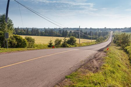 canada agriculture: Empty road passing through landscape, Prince Edward Island, Canada
