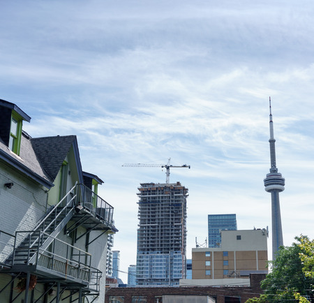 building cn tower: Buildings in city against cloudy sky, Toronto, Ontario, Canada