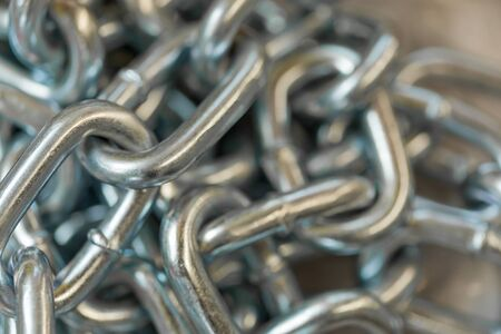 Heap of silver colored metallic chain Stock Photo