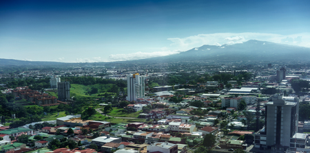 Aerial view of cityscape with mountain range in background, Costa Rica 写真素材