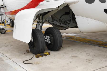chock: Wheel chocks deployed on an airplanes landing gear