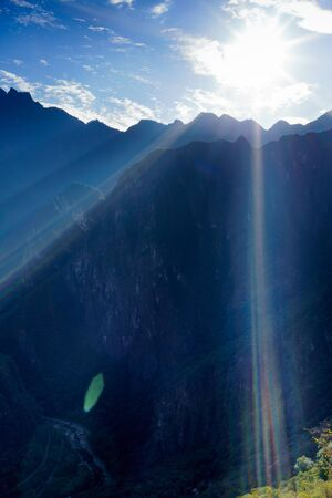 cusco region: Sun shining over mountain range, Machu Picchu, Cusco Region, Urubamba Province, Machupicchu District, Peru