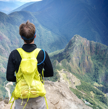cusco region: Rear view of a tourist looking at mountains view in Machu Picchu, Cusco Region, Urubamba Province, Machupicchu District, Peru