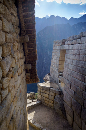 cusco region: Houses with mountains in the background, Machu Picchu, Cusco Region, Urubamba Province, Machupicchu District, Peru Stock Photo