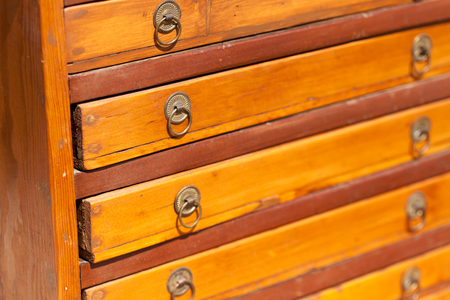 chest of drawers: Full frame shot of wooden chest drawers at flea market Stock Photo