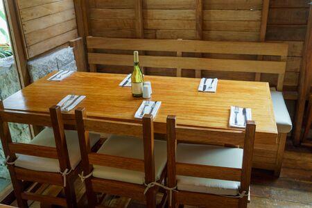 champagne region: Champagne bottle with salt and pepper shaker on wooden table, Machu Picchu, Cusco Region, Urubamba Province, Machupicchu District, Peru Stock Photo