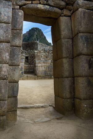 cusco province: View of mountain peak through stone wall in Machu Picchu, Cusco Region, Urubamba Province, Machupicchu District, Peru Stock Photo