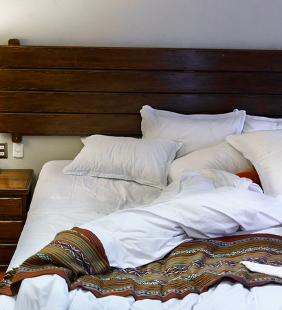 unmade: Unmade bed in hotel room Stock Photo