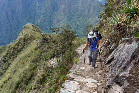 Two hikers walking on Inca trail of Machu Picchu, Cusco Region, Urubamba Province, Machupicchu District, Peru