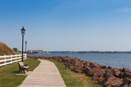 victoria park: Empty bench and footpath at coast, Victoria park, Charlottetown, Prince Edward Island, Canada Stock Photo