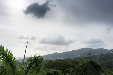 physical geography: Distant view of city with mountain against cloudy sky, Trinidad, Trinidad And Tobago