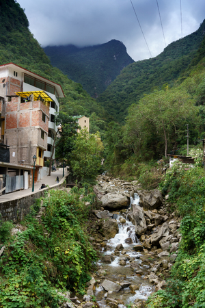 cusco region: Stream with houses against mountain range, Machu Picchu, Cusco Region, Urubamba Province, Machupicchu District, Peru