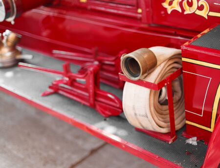 fire engine: Close-up of a fire hose at an antique vintage fire engine, Prince Edward Island, Canada