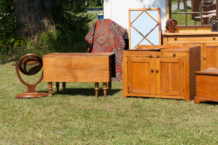 Old furniture for sale at flea market Stock Photo