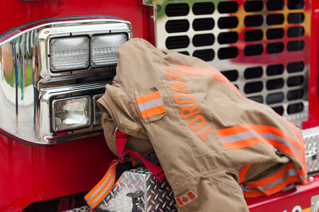 protective suit: Close-up of rescue protective suit on bumper of fire vehicle
