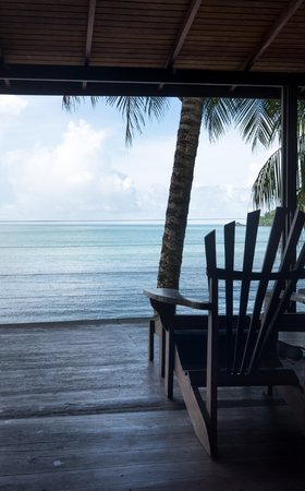 tourist resort: Adirondack chair at a tourist resort and sea viewed through open door of a tourist resort, Trinidad and Tobago