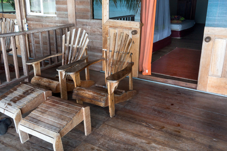 away from it all: Adirondack chairs at porch of tourist resort, Trinidad, Trinidad and Tobago Stock Photo
