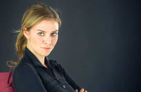 expressing: attractive woman on plein background shot in studio with soft lights with an interesting expression and dramatic lighting Stock Photo