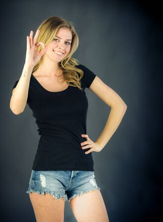 alright: attractive woman on plein background shot in studio with soft lights with an interesting expression and dramatic lighting Stock Photo