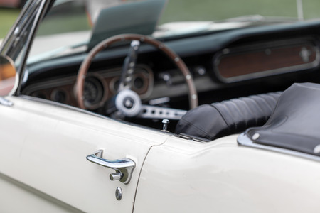 colour image: Antique, Car, Car Door, Close-up, Collectors Car, Colour Image, Control, Convertible, Dashboard, Day, Differential Focus, Elegance, Handle, Horizontal, Lock, Luxury, Metal, Mode Of Transport, Motor Vehicle, No People, Nostalgia, Old, Old-fashioned, Outdo Stock Photo