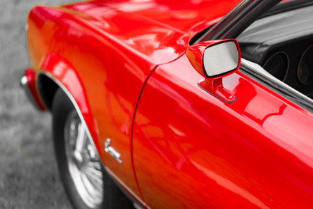 retro styled: Colour Image, Horizontal, Photography, Day, Outdoors, No People, Red, Antique, Car, Close-up, Collectors Car, Differential Focus, Elegance, Land Vehicle, Luxury, Metal, Mode Of Transport, Motor Vehicle, Nostalgia, Old, Old-fashioned, Retro Styled, Shiny,