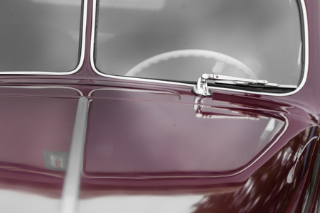 windscreen wiper: Antique, Bonnet, Car, Chrome, Close-up, Collectors Car, Colour Image, Day, Differential Focus, Elegance, Front View, Glass - Material, Horizontal, Land Vehicle, Luxury, Maroon, Metal, Mode Of Transport, Motor Vehicle, No People, Nostalgia, Old, Old-fashi Stock Photo
