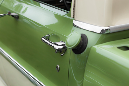 car door: Antique, Car, Car Door, Chrome, Closed, Close-up, Collectors Car, Colour Image, Day, Differential Focus, Elegance, Green, Handle, Horizontal, Keyhole, Lock, Luxury, Metal, Mode Of Transport, Motor Vehicle, No People, Nostalgia, Old, Old-fashioned, Outdoo