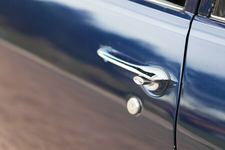 car door: Antique, Blue, Car, Car Door, Chrome, Closed, Close-up, Collectors Car, Colour Image, Day, Differential Focus, Elegance, Full Frame, Handle, Horizontal, Keyhole, Lock, Luxury, Metal, Mode Of Transport, Motor Vehicle, No People, Nostalgia, Old, Old-fashio Stock Photo