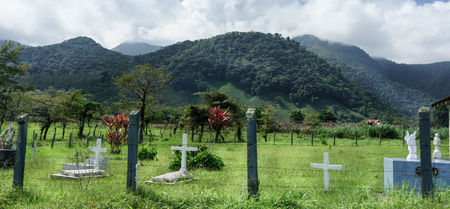 tranquillity: Outdoors, Photography, Scenics, Sky, Fence, Landscape, Field, Memories, Grave, Day, Memorial, Cemetery, Christianity, The End, Gravestone, Tranquillity, Mountain Range, Mountain, Cloud - Sky, Colour Image, Costa Rica, Cross, Death, Horizontal, No People,  Stock Photo