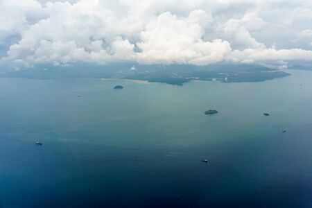 tranquillity: Colour Image, Photography, Day, Outdoors, No People, Aerial View, Costa Rica, Sea, Seascape, Nature, Scenics, Beauty In Nature, Island, Idyllic, Majestic, Awe, Blue, Remote, Tranquil Scene, Tranquillity, Water, Non-urban Scene, Boat, Travel, Nautical Vess Stock Photo
