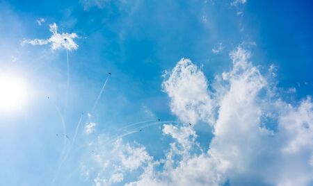 coordination: Acrobatic Activity, Aerobatics, Aeroplane, Aerospace Industry, Air Force, Air Vehicle, Airplane, Airshow, Blue, Cloud - Sky, Colour Image, Cooperation, Co-ordination, Day, Fighter Plane, Flying, Formation Flying, Horizontal, Low Angle View, Mid-air, Milit