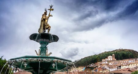 colour image: Art And Craft, Bronze - Alloy, Carving - Craft Product, Cloud - Sky, Colour Image, Creativity, Cusco City, Day, Falling Water, Famous Place, Fountain, History, Horizontal, Human Representation, Inca, Low Angle View, Male Likeness, No People, Outdoors, Per