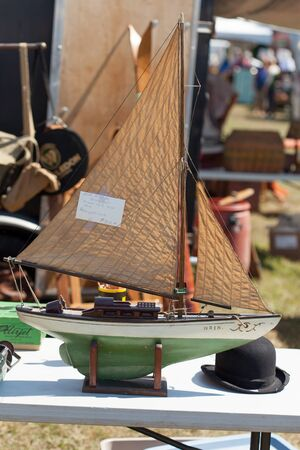 passenger ship: Man Made Object, Retro Styled, The Past, Still Life, Nautical Vessel, Toy, Antique, Sailing, Table, Shop, Ship, Small, Colour Image, Day, Vertical, Mast, No People, Old-fashioned, Outdoors, Passenger Ship, Photography, Sailing Boat, Transportation, Wood - Stock Photo