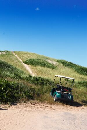 grass area: Nature, Grass Area, Green, Grass, Clear Sky, Blue, Golf Cart, Day, Sunlight, Mode Of Transport, Land Vehicle, Transportation, Outdoors, Sport, Stationary, Vertical, Golf, Golf Course, Colour Image, Photography, Summer, Sunny, Green - Golf Course, Non-urba