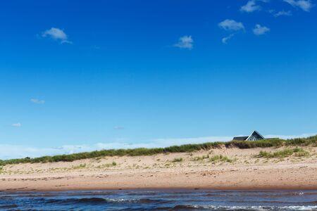 tranquillity: Non-urban Scene, Tranquillity, Tranquil Scene, Beauty In Nature, Travel Destinations, Travel, No People, Sand, Prince Edward Island, Canada, Wave, Surf, Cloud - Sky, Blue, Landscape, Water, Sea, Beach, Coastline, Horizontal, Majestic, Sunlight, Hut, Built