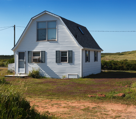tranquillity: Residential Building, Prince Edward Island, Canada, Building Entrance, Window, Closed, Door, White, Day, Outdoors, Photography, Nature, Field, Sky, Sunlight, Tranquillity, Grass, Architecture, Building Exterior, House, Built Structure, Colour Image, No Pe