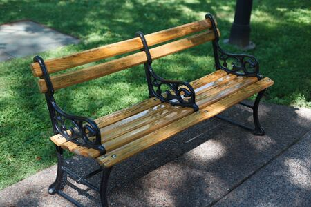 tranquillity: Park Bench, Elevated View, Colour Image, Photography, No People, Horizontal, Outdoors, Day, Sunlight, Shadow, Green, Grass, Wood - Material, Iron - Metal, Bench, Empty, Absence, Differential Focus, Park - Man Made Space, Tranquillity, Prince Edward Island