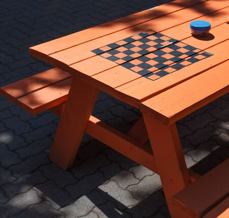 Prince Edward Island, Canada, Box - Container, Sunlight, Shadow, Brown, Furniture, Picnic Table, No People, Outdoors, Day, Colour Image, Cobblestone, Street, Photography, Vertical, Table, Chess Board, Checked Pattern, Pattern, Wood - Material, Empty, Abse 스톡 콘텐츠
