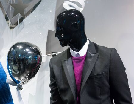 consumerism: Black, Close-up, Clothes Shop, Clothing Store, Coat, Colour Image, Consumerism, Display, Fashion, For Sale, Horizontal, Human Face, Human Representation, Indoors, Lifestyles, Male Likeness, Mannequin, Merchandise, No People, Photography, Reflection, Retai Stock Photo