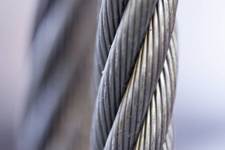 durability: Cable, Close-up, Colour Image, Connection, Day, Differential Focus, Durability, Electricity, Engineering, Horizontal, Industry, Metal, Metallic, No People, Outdoors, Photography, Power Supply, Protection, Safety, Silver Coloured, Sky, Steel, Steel Cable,