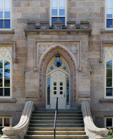 building entrance: Day, Outdoors, Stone Wall, Railings, Building Entrance, Sunlight, Steps And Staircases, Steps, Cathedral, Arch, Place Of Worship, Christianity, Religion, Catholicism, Spirituality, Architecture, Church, History, The Past, Door, Closed, Architectural Featu
