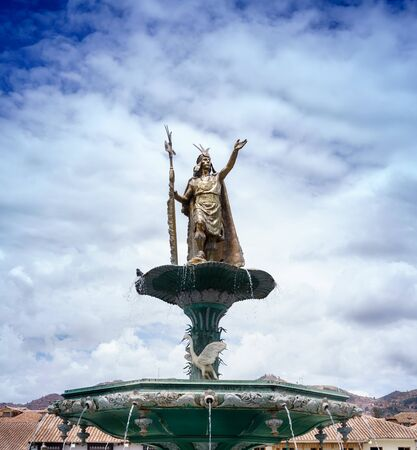 cu: Art And Craft, Bronze - Alloy, Carving - Craft Product, Cloud - Sky, Colour Image, Creativity, Cusco City, Day, Famous Place, Fountain, History, Human Representation, Inca, Low Angle View, Male Likeness, No People, Outdoors, Peru, Photography, Peruvian Cu Stock Photo